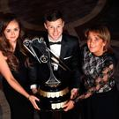 Main man: Jonathan Rea shows off the Joey Dunlop Trophy alongside the late William Dunlop's partner Janine Brolly and mother Louise Dunlop