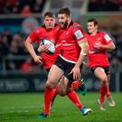 Running man: Stuart McCloskey surges forward against Scarlets in the Champions Cup, and is now eager to finish the job and achieve knockout rugby