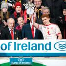 Tyrone triumph: Peter Harte lifts the Dr McKenna Cup after his team ran out winners by two points in a fierce encounter with rivals Armagh