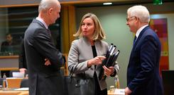 High Representative of the European Union for Foreign Affairs and Security Policy Federica Mogherini (C) talks with Dutch Foreign Minister Stef Blok (L) and Polish Foreign Minister Jacek Czaputowicz (R) during a meeting at the EU headquarters in Brussels on January 21, 2019. (Photo by LOIC VENANCE / AFP)LOIC VENANCE/AFP/Getty Images