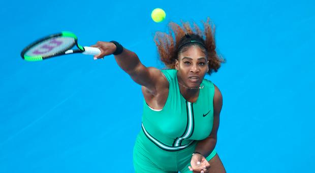 On serve: Serena Williams serves during her victory over Simona Halep
