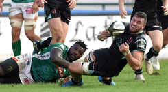 Going down: Ulster's Kieran Treadwell is tackled by Benetton's Derrick Appiah during the sides' clash in Treviso earlier in the season