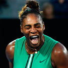 Get in: Serena Williams celebrates reaching the quarters with her victory over Simona Halep in Melbourne