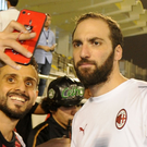 Picture that: Gonzalo Higuain poses with AC Milan fans