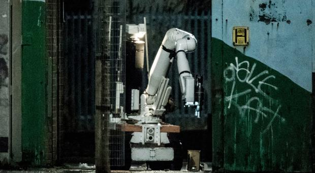 A police robot at the scene of a security alert in the Lanark Way area of west Belfast, which was sparked by a suspicious object