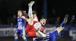Going down: Linfield ace Jamie Mulgrew is upended