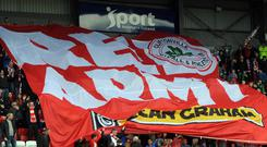 A section of Cliftonville fans are being made to work to see their team in action tonight.