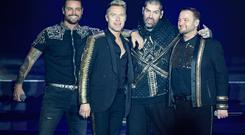 Keith Duffy, Ronan Keating, Shane Lynch and Mikey Graham of Boyzone on stage at the SSE Arena, Belfast, as part of the band's Thank You & Goodnight farewell tour.