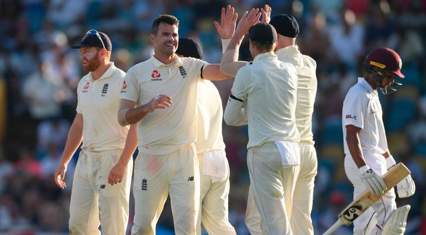 On target: James Anderson celebrates after taking the wicket of Shane Dowrich