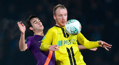 Behind you: Eric Garcia puts pressure on Liam Boyce