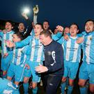 Rising stars: Warrenpoint Town players celebrate promotion to the Premiership in 2013