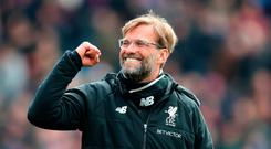 All smiles: Jurgen Klopp is not concerned if his side play after title rivals Man City