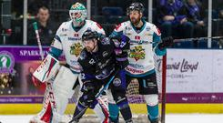 Belfast Giants defenceman Jim Vandermeer battles with Guillaume Doucet of the Glasgow Clan in Tuesday night's Challenge Cup semi-final first leg at the Braehead Arena