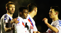 On target: Gareth McAuley leads the praise for Lassana Coulibaly after his goal