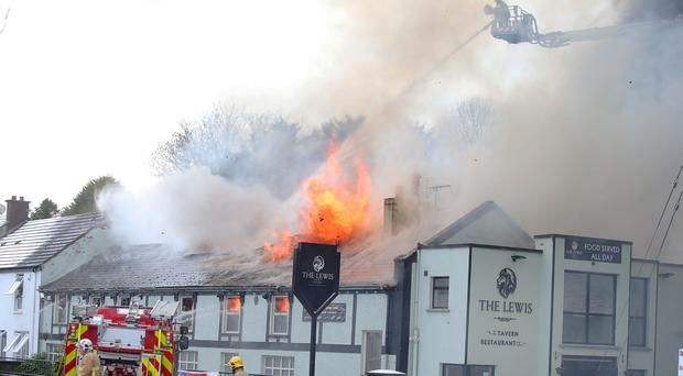 The scene at the Lewis pub in Dundonald, east Belfast, where a mayor fire is taking place. Picture by Jonathan Porter/PressEye
