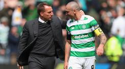 Scott Brown (right) is staying at Brendan Rodgers' Celtic.