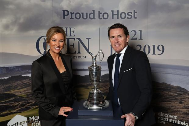 Claire McCollum and AP McCoy with the famous Claret Jug at the Tourism NI launch of The Open in Portrush. Pic Presseye