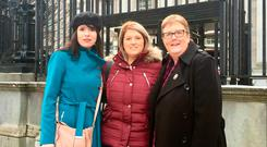 Sarah Ewart (centre) with mum Jane Christie and Amnesty International's Grainne Teggart (left) on day two of the judicial review of Northern Ireland's abortion laws