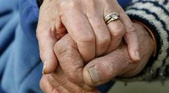 Northern Ireland's health watchdog is at the centre of High Court action over its decision to register a facility owned by a disgraced care home firm