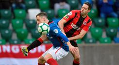Tight marking: Sean Ward tussles with Linfield ace Joel Cooper