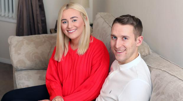 Ballymena United's Jonny Addis with his fiancee Olivia at home in Carrickfergus.