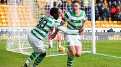 Celtic's James Forrest celebrates with Timothy Weah after scoring the first goal during the Ladbrokes Scottish Premiership match at McDiarmid Park, Perth.