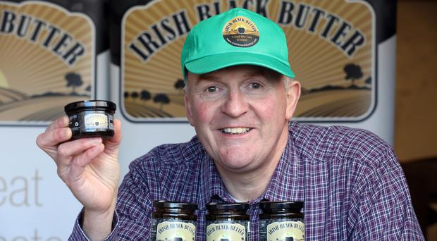 Alastair Bell of Irish Black Butter with examples of his product