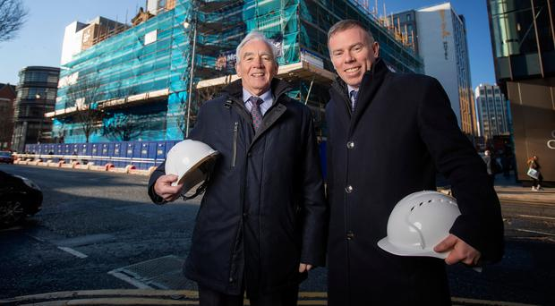 McAleer & Rushe chairman Seamus McAleer (left) with Deloitte's Colin Mounstephen launching the third Belfast Crane Survey outside the Tyrone firm's Bedford Square development, which will be Deloitte's new Belfast headquarters when completed in 2021