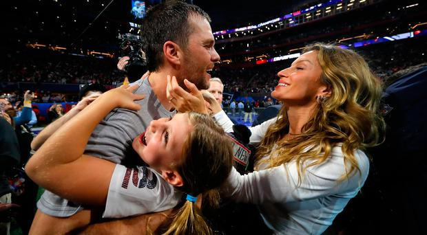 Party time: Super Bowl winner Tom Brady celebrates with wife Gisele Bundchen and daughter Vivian