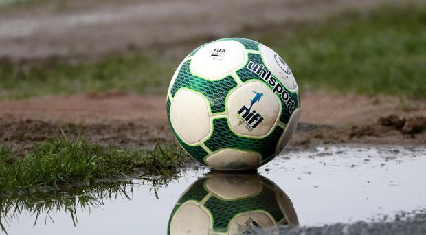 The Ballymena Showgrounds pitch is waterlogged, leading to the postponement of the County Antrim Shield final.