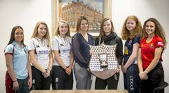 Strathearn's Chloe Sweet, Rainey's Betty Scott and Ellie Montgomery, Ballyclare's Rebecca McCullough and Banbridge Academy's Nadia Benallal at the semi-final draw along with Ireland star Megan Frazer and Belfast Telegraph's Sarah Little.