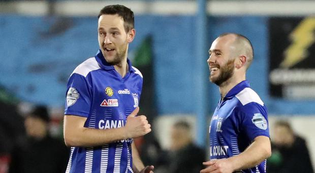 Newry's Stephen Hughes (right) celebrates giving his side the lead against Glentoran.