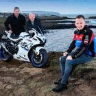 All set: Buildbase Suzuki BSB rider Richard Cooper (right), who will make his road racing debut at this year's NW200, at the north coast with Clerk of the Course Stanleigh Murray (far left) and Event Director Mervyn Whyte