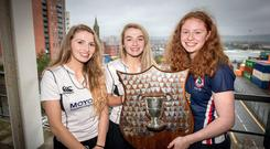 Hands on: Rainey's Betty Scott and Ellie Montgomery and Ballyclare's Rebecca McCullough at the semi-final draw in Belfast Telegraph House