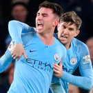 Net gains: Aymeric Laporte celebrates his opener in City's win over Everton which takes them top