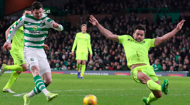 Finisher: Celtic's Oliver Burke scores his side's second goal of the game against Hibernian last night