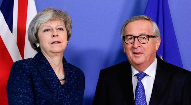 British Prime Minister Theresa May is welcomed by European commission President Jean-Claude Juncker ahead to a meeting on Brexit, on February 7, 2019 in Brussels. (Photo by Aris Oikonomou / AFP)ARIS OIKONOMOU/AFP/Getty Images