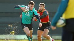 Charging through: Jacob Stockdale and Adam Byrne at Ireland training yesterday