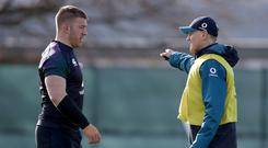 Listening up: Sean O'Brien pays attention to what Ireland coach Joe Schmidt has to say in training
