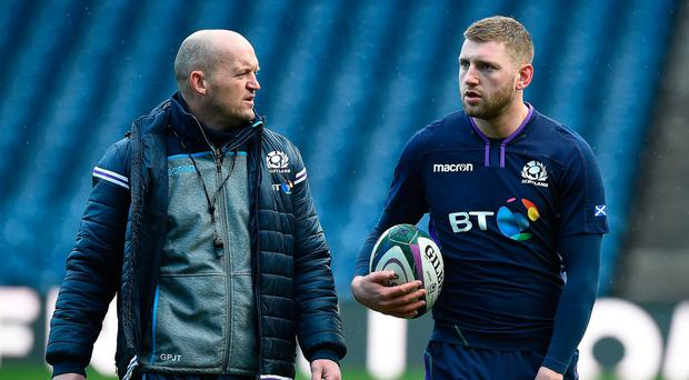 Listen up: Scotland coach Gregor Townsend passes on some instructions to Finn Russell during the captain's run