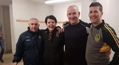 Assistant manager Pat Hughes (left), manager Frankie Fitzsimmons (third left), husband and wife Declan Steele (right) and Sinead Larkin after Ulster Cup final