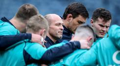 Bonding exercise: Rory Best (centre) and his Ulster and Ireland team-mate Jacob Stockdale (right) in a team huddle during yesterday's captain's run at Murrayfield