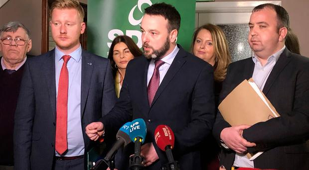 SDLP leader Colum Eastwood (centre) speaks to the media in Newry. Photo credit: Michael McHugh/PA Wire