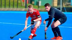 Sticking to it: Cookstown's Jack Haycock and Lisnagarvey's James Corry battle for the ball