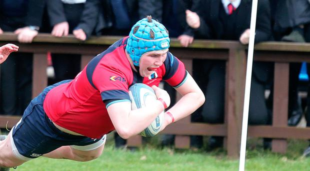 Tough test: Ballyclare's Ethan Crawford crossed for a try but it wasn't enough to see his side progress against Rainey
