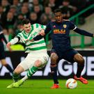 Getting shirty: Oliver Burke with Geoffrey Kondogbia