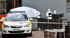Police and forensic officers pictured at the scene where a body of a man was found in the Keylands Place area on Friday afternoon. Mandatory Credit Presseye /Stephen Hamilton