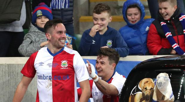 Linfield's Andrew Waterworth celebrates opening the scores. Photo by David Maginnis/Pacemaker Press