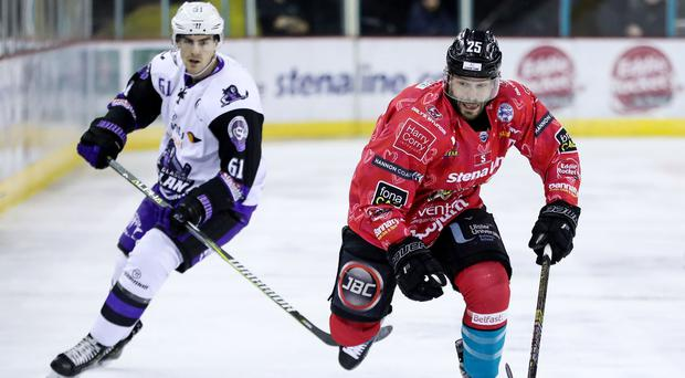 Belfast Giants' Blair Riley with Glasgow Clan's Scott Pitt during Saturday night's Elite Ice Hockey League game at the SSE Arena, Belfast