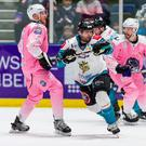 Not enough: Belfast Giants winger Patrick Dwyer battles with Glasgow Clan forward Scott Tanski
